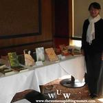 December 9, 2011 Women Uplifting Women Luncheon key note speaker Wanda Winters-Gutierrez displaying her books.